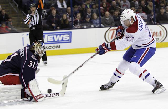 Montreal Canadiens' Alex Galchenyuk, right, scores against Columbus Blue Jackets' Curtis McElhinney during the first period of an NHL hockey game Friday, Nov. 15, 2013, in Columbus, Ohio. (AP Photo/Jay LaPrete)