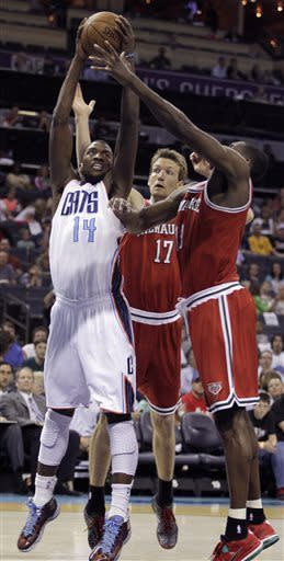 Charlotte Bobcats' Michael Kidd-Gilchrist, left, battles the Milwaukee Bucks' Mike Dunleavy, center and Ekpe Udoh, right, for control of the loose ball during the first half of an NBA basketball game in Charlotte, N.C., Saturday, April 13, 2013. (AP Photo/Bob Leverone)