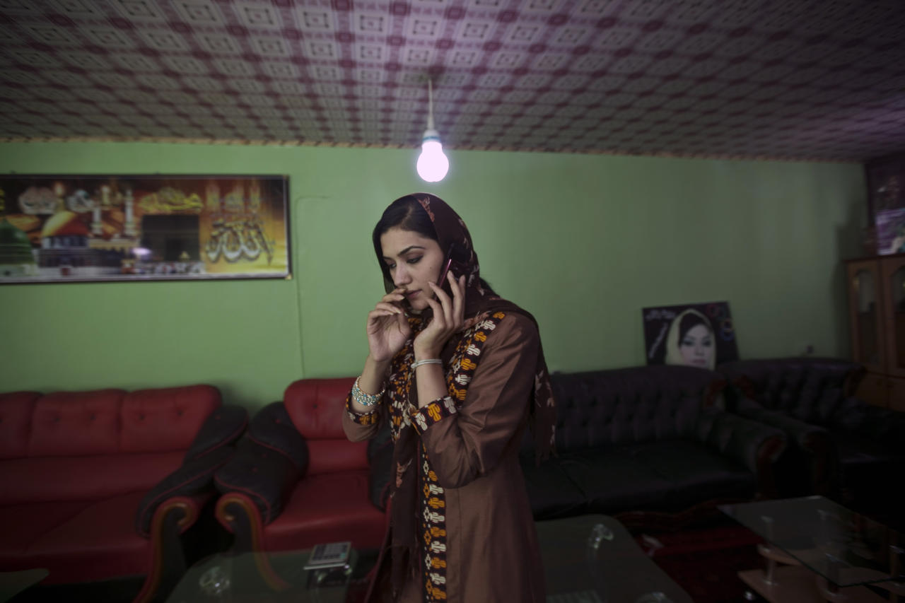 Robina Jelali, an Afghan candidate for the parliamentary election speaks on her phone at her office in Kabul September 7, 2010.  Twenty-five-year-old Robina Jelali, an ex-Olympic runner and now head of a women's charity in Kabul, said Afghanistan's deeply conservative nature alone made it harder for women at the elections. Picture taken September 7, 2010. REUTERS/Ahmad Masood  (AFGHANISTAN - Tags: ELECTIONS POLITICS)
