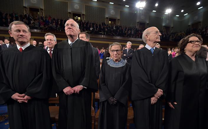 From left, Chief Justice John G. Roberts and Supreme Court justices Anthony M. Kennedy, Ruth Bader Ginsburg, Stephen G. Breyer and Sonia Sotomayor stand before President Barack Obama's State Of The Union address on Tuesday, Jan. 20, 2015, on Capitol Hill in Washington. (Mandel Ngan, Pool/AP Photo)