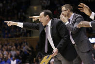 FILE - In this Nov. 26, 2019, file photo, Duke head coach Mike Krzyzewski directs his team as associate head coach Jon Scheyer shouts from behind him during the second half of an NCAA college basketball game against Stephen F. Austin in Durham, N.C. Duke Hall of Fame coach Mike Krzyzewski will coach his final season with the Blue Devils in 2021-22, a person familiar with the situation said Wednesday, June 2, 2021. The person said former Duke player and associate head coach Jon Scheyer would then take over as Krzyzewski's successor for the 2022-23 season. (AP Photo/Gerry Broome, File)