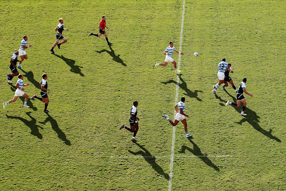 """Fast passing interchanges are at the heart of rugby's appeal, and here Cameron Spencer (Getty Images) captures a classic Argentinian counter attack as Cruz Mallia offloads the ball to Gonzalo Martin Bertranou. Argentina won the match 47 - 17. Cameron went high in the stands late in the game for this shot: """"I wanted to go up there as late as possible so the shadows were long and defined - without the light this image would be far less graphic."""""""