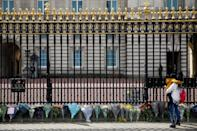 <p>In response to his passing, memorials are emerging for the royal, who had been married to Queen Elizabeth II for 73 years. </p> <p>Right, flowers line the fence of Buckingham Palace on April 9. </p>