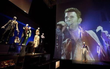 "A variety of stage costumes worn by musician David Bowie are seen at the ""David Bowie is"" Exhibition at the Victoria and Albert Museum in London"