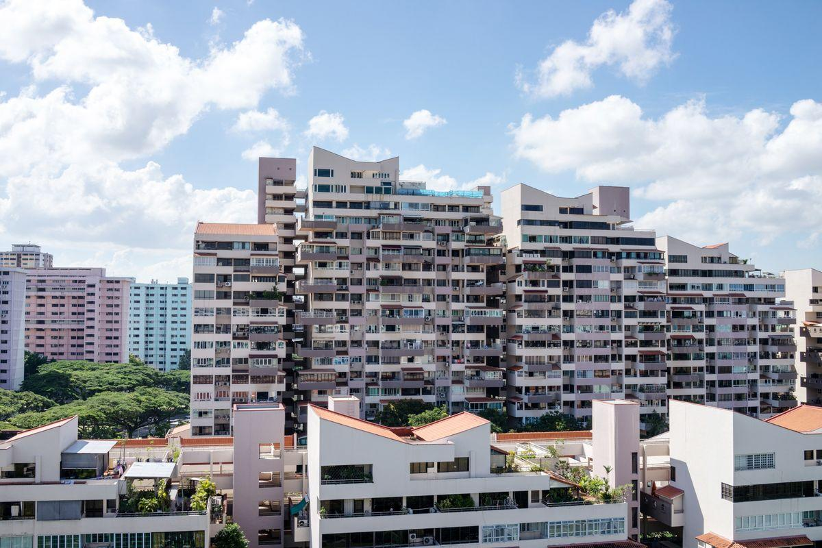 Residential buildings stand in the Bedok area of Singapore, on Saturday, June 3, 2017. Hunger for Singapore land is adding to signs the city's housing market is making a comeback after three years of declining prices. With new home sales surging after an easing of property restrictions in March, developers are becoming more aggressive in bidding at land auctions. Photographer: Sanjit Das/Bloomberg