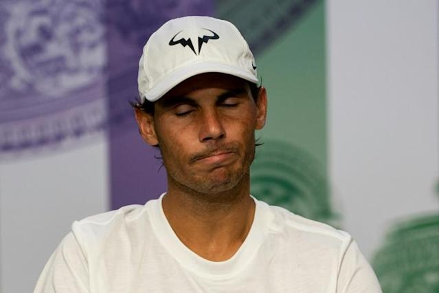 Nadal rues passage of time is making it less likely a third Wimbledon title will come his way (AFP Photo/Adam WARNER)