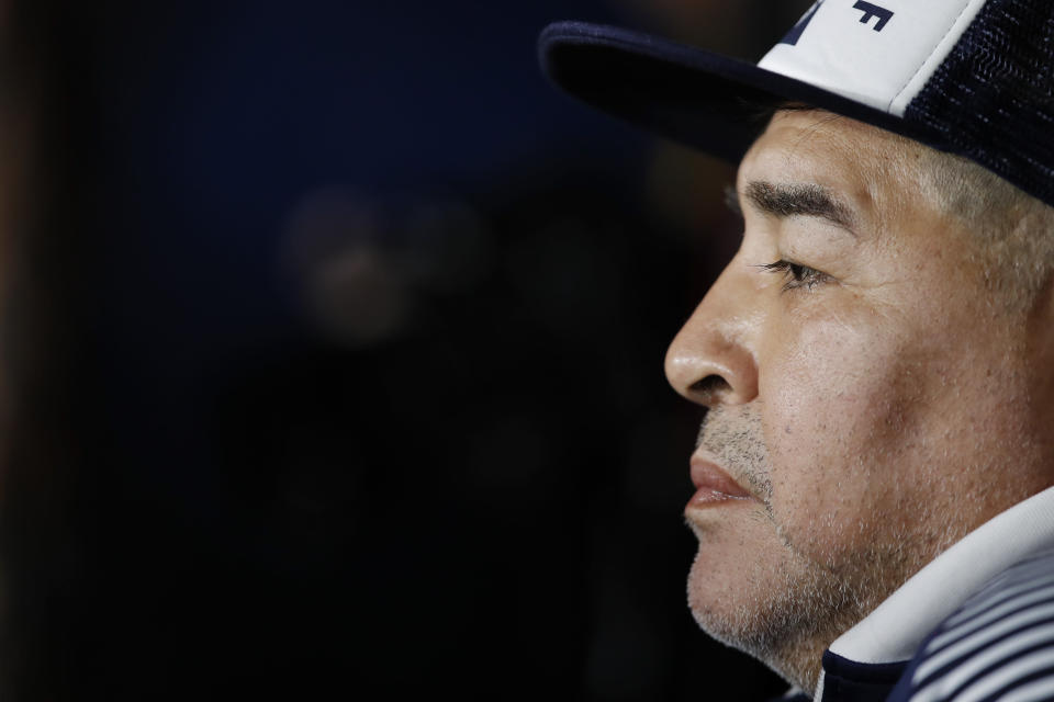 Gimnasia y Esgrima's coach Diego Maradona sits at the bench prior to an Argentina's soccer league match against Boca Juniors at La Bombonera stadium in Buenos Aires, Argentina, Saturday, March 7, 2020. (AP Photo/Natacha Pisarenko)