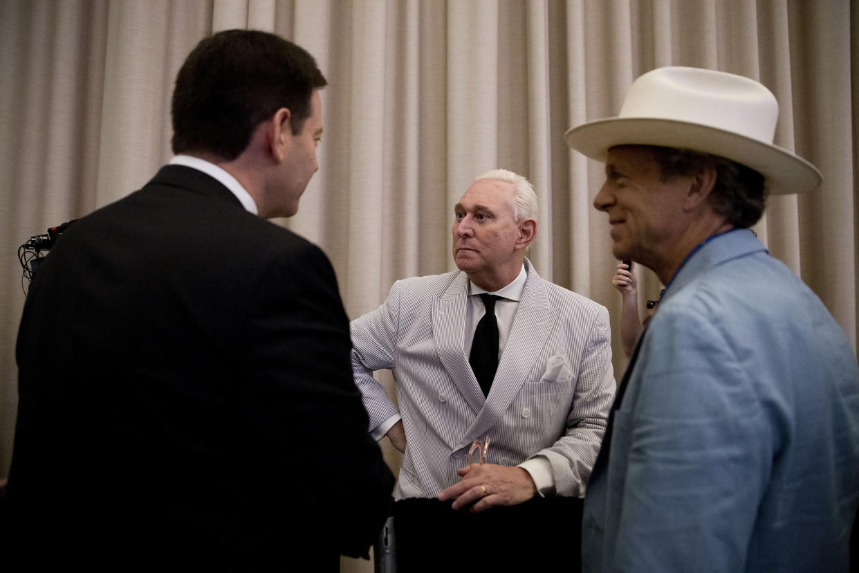 Roger Stone, center, speaks to reporters before the start of a July campaign event where Donald Trump announced Indiana Gov. Mike Pence as his vice presidential running mate. (Photo: Mary Altaffer/AP)