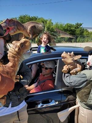 The Jurassic Quest Drive Thru is the only place to encounter some of the largest dinosaurs to ever roam the Earth, and meet our one-of-a-kind baby dinosaurs, from the safety of your family vehicle. Guests will be among the first in the nation to go on a quest with our adventure-for-all-ages online audio tour that will lead them through the thrilling dinosaur safari. The audio tour is available in English and Spanish.