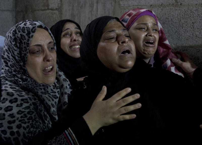 Palestinian relatives of 23 year-old Hamas fighter, Ahmad Morjan, mourn at the family home during his funeral, in the Jabaliya refugee camp, Northern Gaza Strip, Tuesday, Aug. 7, 2018. The Israeli military said it targeted a Hamas military post in northern Gaza after militants opened fire, and Hamas said two of its fighters were killed. (AP Photo/Khalil Hamra)