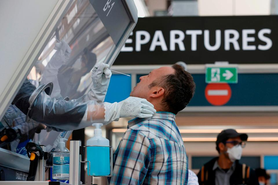 <p>A man is tested for coronavirus at Israel's Ben Gurion International Airport</p> (AFP via Getty Images)
