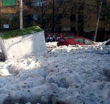 Street covered in ice is pictured after a heavy storm of rain and hail in Guadalajara