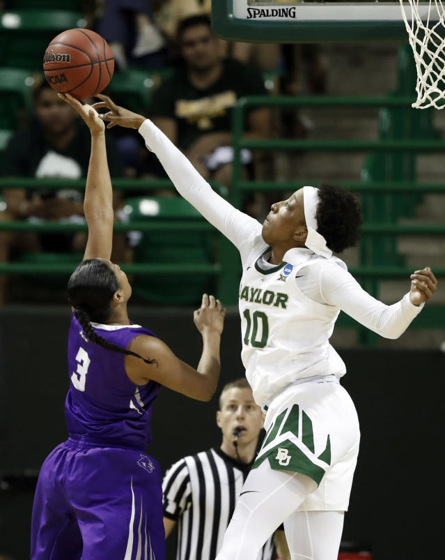 Abilene Christian guard Dominique Golightly (3) has her shot blocked by Baylor forward Aquira DeCosta (10) in the second half of a first-round game in the NCAA women's college basketball tournament in Waco, Texas, Saturday March 23, 2019. (AP Photo/Tony Gutierrez)