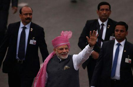 FILE PHOTO - Indian Prime Minister Modi waves towards the crowd as he leaves after attending the Republic Day parade in New Delhi