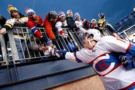 Jan 1, 2016; Foxborough, MA, USA; Montreal Canadiens right wing Brendan Gallagher (11) celebrates with fans after the Winter Classic hockey game against the Boston Bruins at Gillette Stadium. The Canadiens beat the Bruins 5-1. Mandatory Credit: Greg M. Cooper-USA TODAY Sports