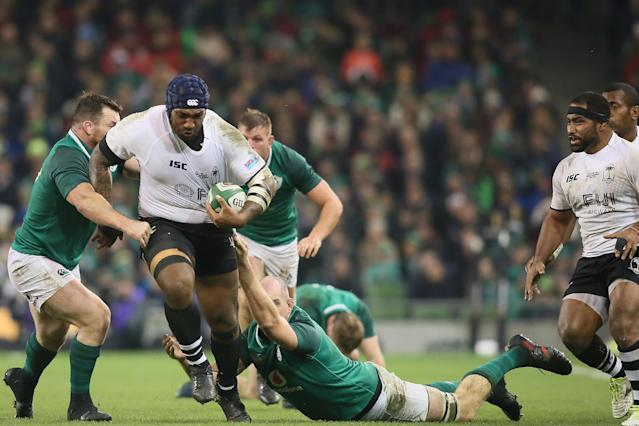 Fiji's wing Nemani Nadolo (2nd L) is tackled during the international rugby union test match between Ireland and Fiji at Aviva stadium in Dublin on November 18, 2017.Ireland won the game 23-20. (AFP Photo/Paul FAITH)