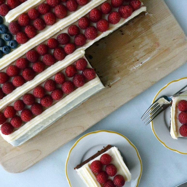 """If you're feeling retro, and you have a bunch of berries on hand, wrap up your 4th of July celebration with this stars-and-stripes chocolate cake with tangy cream cheese frosting. <a href=""""https://www.epicurious.com/recipes/food/views/july-4th-flag-cake-51170010?mbid=synd_yahoo_rss"""" rel=""""nofollow noopener"""" target=""""_blank"""" data-ylk=""""slk:See recipe."""" class=""""link rapid-noclick-resp"""">See recipe.</a>"""