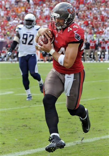 Tampa Bay Buccaneers tight end Dallas Clark (44) pulls in a three-yard touchdown pass after getting past San Diego Chargers defensive end Vaughn Martin (92) during the first quarter of an NFL football game, Sunday, Nov. 11, 2012, in Tampa, Fla. (AP Photo/Brian Blanco)