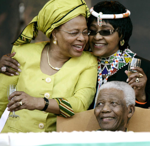 <p>Former South African President Nelson Mandela with his former wife Winnie Mandela, right, and current wife Graca Machel at the ANC Madiba 90th Birthday Celebrations on Aug. 2, 2008, in Tshwane, South Africa. (Photo: Michelly Rall/WireImage via Getty Images) </p>