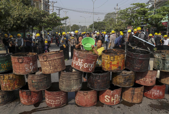 People build barricades to deter security personnel from entering a protest area in Mandalay, Myanmar, Thursday, March 4, 2021. Demonstrators in Myanmar protesting last month's military coup returned to the streets Thursday, undaunted by the killing of at least 38 people the previous day by security forces. (AP Photo)