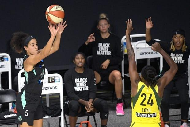 Kia Nurse, who spent last season with the WNBA's New York Liberty, will be part of the NBA's first all-women's broadcast team when the Toronto Raptors face the Denver Nuggets on Wednesday. (Phelan M. Ebenhack/The Associated Press - image credit)