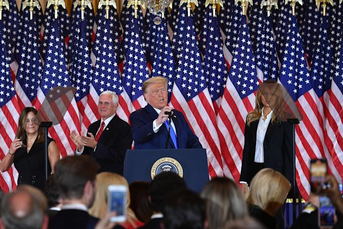 US President Donald Trump arrives to speak, flanked by Karen Pence, US Vice President Mike Pence and US First Lady Melania Trump. during election night in the East Room of the White House in Washington, DC, early on November 4, 2020.