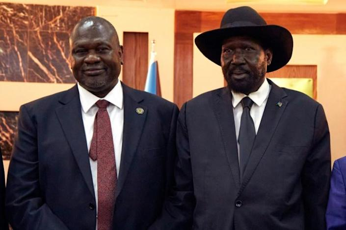 South Sudanese President Salva Kiir (right) pictured in February 2020 with his one-time rival turned deputy Riek Machar