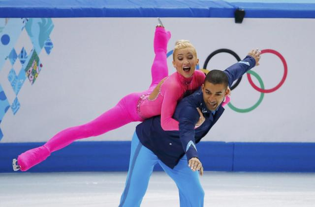 Germany's Aliona Savchenko and Robin Szolkowy compete during the Figure Skating Pairs Short Program at the Sochi 2014 Winter Olympics, February 11, 2014. REUTERS/David Gray (RUSSIA - Tags: OLYMPICS SPORT FIGURE SKATING)