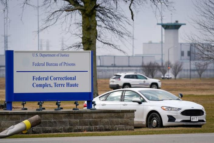 Prison officials patrol around the United States Penitentiary at the Federal Correctional Complex in Terre Haute