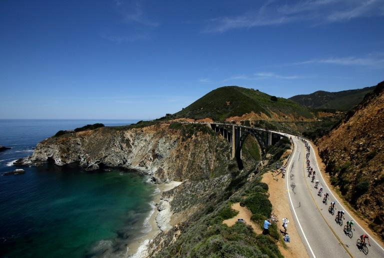 The peloton rides along the coast near Monterey in the 2014 Tour of California, won by Bradley Wiggins