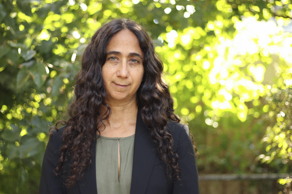 In this Sept. 20, 2021, photo Rachel Meeropol, senior staff attorney with the Center for Constitutional Rights, who filed a lawsuit in 2002 on behalf of several of the men who were detained and ultimately deported after Sept. 11, poses for a photo in the Brooklyn borough of New York. In the weeks after the Sept. 11 attacks more than 1,000 South Asian and Arab men were arrested in sweeps across the New York City metropolitan area and nationwide. Most were charged only with overstaying visas and deported back to their home countries. But before that happened, many were held in detention for months, with little outside contact, especially with their families. (AP Photo/Noreen Nasir)