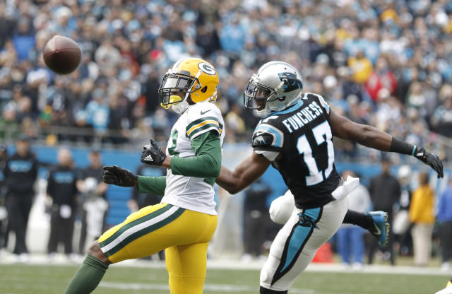 A pass to Carolina Panthers' Devin Funchess (17) falls incomplete as Green Bay Packers' Damarious Randall (23) defends during the first half of an NFL football game in Charlotte, N.C., Sunday, Dec. 17, 2017. (AP Photo/Bob Leverone)