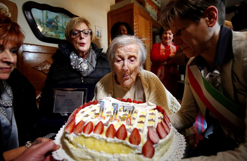 <p>Emma Morano, thought to be the world's oldest person and the last to be born in the 1800s, blows candles during her 117th birthday in Verbania, northern Italy November 29, 2016. (Alessandro Garofalo/Reuters) </p>