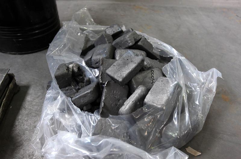 Neodymium ingots sit in a bag prior to being crushed at Neo Material Technologies Inc.'s Magnequench Tianjin Co. factory in Tianjin, China, on Friday, June 11, 2010. A generation after Chinese leader Deng Xiaoping made mastering neodymium and 16 other elements known as rare-earths a priority, China has cornered the market, with far-reaching effects ranging from job losses and global trade to U.S. national security. Photographer: Doug Kanter/Bloomberg via Getty Images