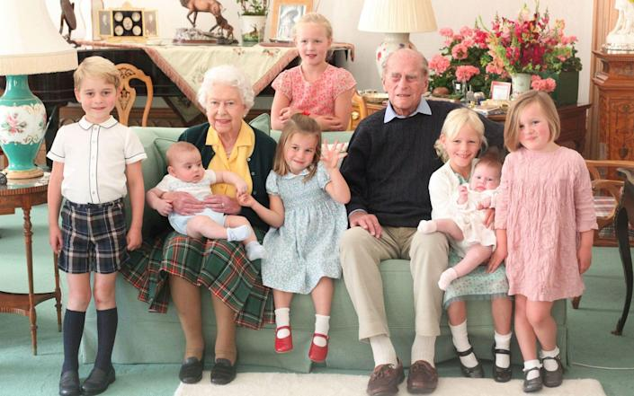 Queen Elizabeth and Prince Philip with their great grandchildren. Pictured (L-R) are Prince George, Prince Louis being held by Queen Elizabeth, Savannah Phillips (standing at rear), Princess Charlotte, Prince Philip, Isla Phillips holding Lena Tindall, and Mia Tindall - The Duchess of Cambridge/Kensington Palace