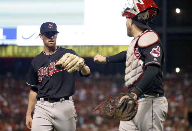 Cleveland Indians starting pitcher Shane Bieber, left, is congratulated by Roberto Perez after getting St. Louis Cardinals' Yadier Molina to ground out, ending the fifth inning of a baseball game Wednesday, June 27, 2018, in St. Louis. (AP Photo/Jeff Roberson)