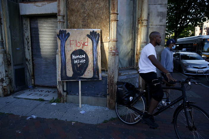 BOSTON, MA - MAY 31: A poster is seen leaning on the side of a building during a peaceful march in Boston on May 31, 2020 to protest the death of George Floyd who was killed by a police officer. (Photo by Jessica Rinaldi/The Boston Globe via Getty Images)