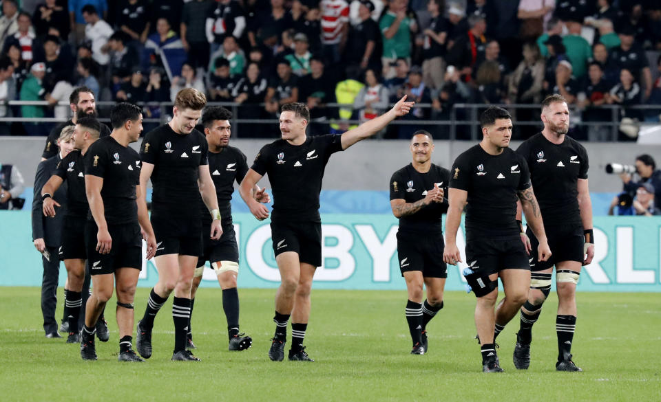 New Zealand's players acknowledge cheering fans after the Rugby World Cup quarterfinal match at Tokyo Stadium between New Zealand and Ireland in Tokyo, Japan, Saturday, Oct. 19, 2019. (AP Photo/Eugene Hoshiko)