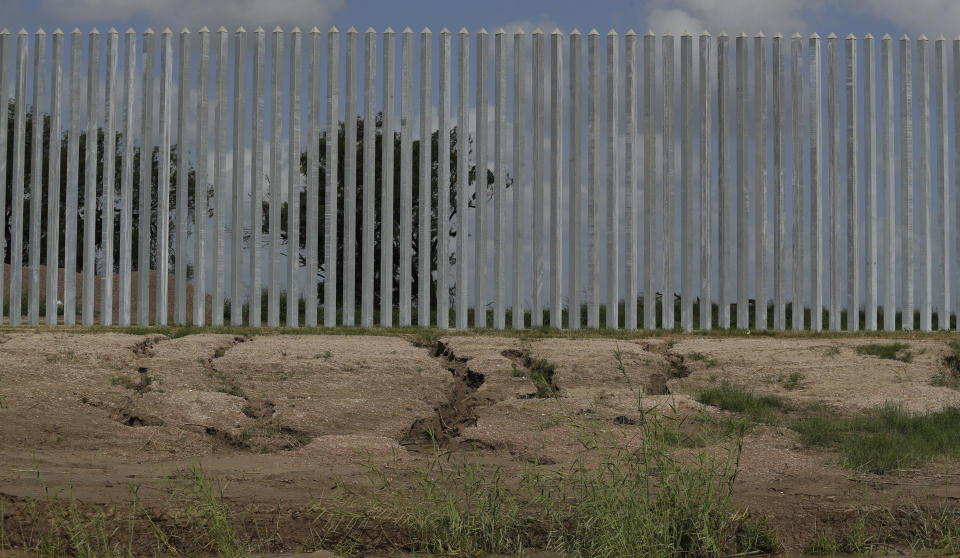 Erosion damage caused by Hurricane Hanna is seen along the Fisher border wall, a privately funded border fence, along the Rio Grande River near Mission, Texas, Thursday, July 30, 2020. The wall was built by a construction company that's won $1.3 billion in U.S. government contracts and promoted by supporters of President Donald Trump. (AP Photo/Eric Gay)