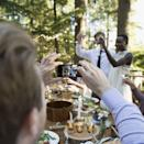 """<p>We get it: You really want to show off how much you love the newlyweds with their adorable Instagram hashtag<em> but</em> experts say it's best to wait until after they say """"I do."""" """"Guests should refrain from taking photos or videos during the ceremony, if the couple asked them to,"""" says Shawna Orwoll from <a href=""""https://www.awaywegoweddings.com/"""" rel=""""nofollow noopener"""" target=""""_blank"""" data-ylk=""""slk:Away We Go Weddings"""" class=""""link rapid-noclick-resp"""">Away We Go Weddings</a>. """"Religious or not, a wedding ceremony is a sacred moment for the couple and should be treated accordingly."""" </p>"""