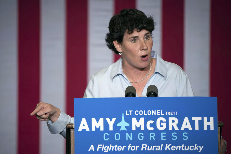 """FILE - In this Oct. 12, 2018, file photo, Democratic congressional candidate Amy McGrath speaks during a campaign event in Owingsville, Ky. Democrat Amy McGrath's campaign released a TV ad Friday, April 3, 2020, lambasting the Kentucky Republican and Senate Majority Leader Mitch McConnell for """"taking a victory lap against the coronavirus."""" (AP Photo/Bryan Woolston, File)"""