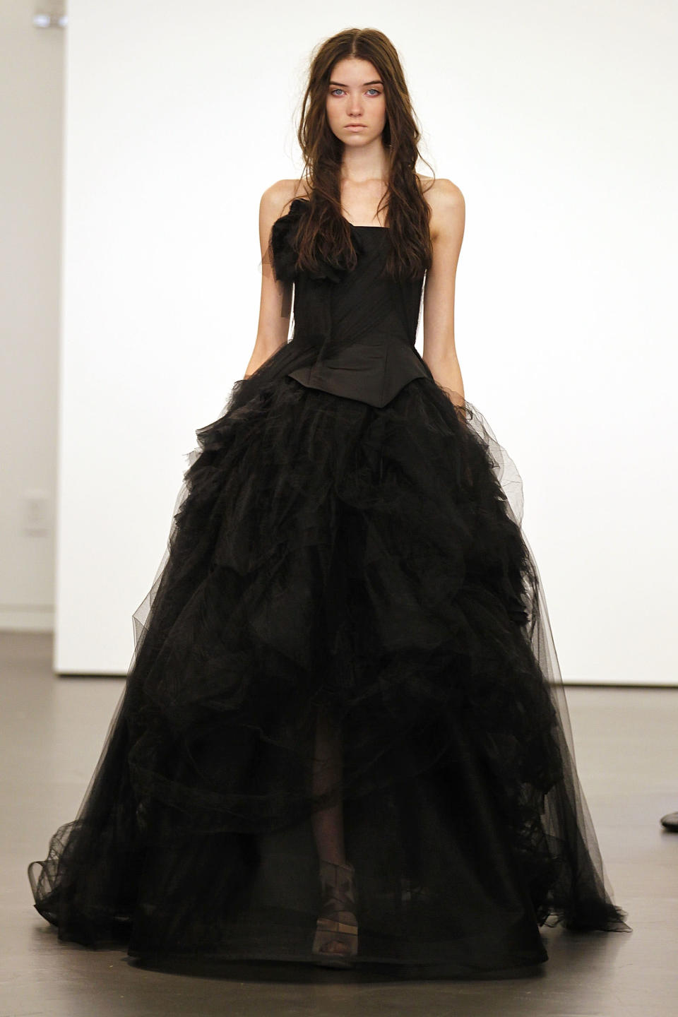 "<div class=""caption-credit"">Photo by: Getty</div><p> Vera Wang, 2011. A gown from the runway show that started it all. The designer included 15 black dresses. </p> <p> Also on Shine: </p> <p> <a href=""http://yhoo.it/16jDHWm"" rel=""nofollow noopener"" target=""_blank"" data-ylk=""slk:This Couple Really Loves Disney: Wedding Photos"" class=""link rapid-noclick-resp"">This Couple Really Loves Disney: Wedding Photos</a> </p> <p> <a href=""http://yhoo.it/10mz5hr"" rel=""nofollow noopener"" target=""_blank"" data-ylk=""slk:Wedding Dress Trends for 2013"" class=""link rapid-noclick-resp"">Wedding Dress Trends for 2013</a> </p> <p> <a href=""http://yhoo.it/16jDHWm"" rel=""nofollow noopener"" target=""_blank"" data-ylk=""slk:Wedding Dresses: Short, Beachy, Affordable Styles"" class=""link rapid-noclick-resp"">Wedding Dresses: Short, Beachy, Affordable Styles</a> </p>"