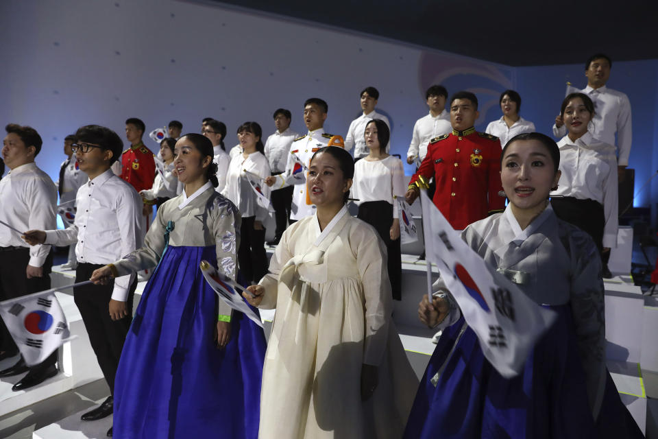 South Koreans perform during the celebration of 75th anniversary of the Liberation Day at Dongdaemun Design Plaza in Seoul Saturday, Aug. 15, 2020. South Korea marked its 75th National Liberation Day on Saturday, which celebrates its independence from Japanese colonial rule following the end of World War II after Japan surrendered. (Chung Sung-jun/Pool Photo via AP)