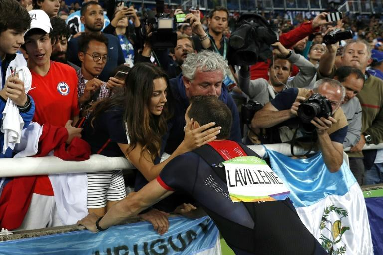 Consoling arms: After Renaud Lavillenie finished second in Rio he was comforted by his partner Anais Poumarat and coach Philippe D'Encausse. That is unlikely to be an option in Tokyo