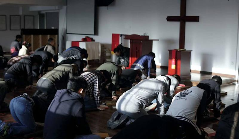 Christian pastor Wang Yi faces subversion charges in China after raid on church