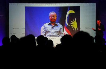 Malaysia's Prime Minister Mahathir Mohamad is seen on video conference screen during the Wall Street Journal CEO Conference in Tokyo