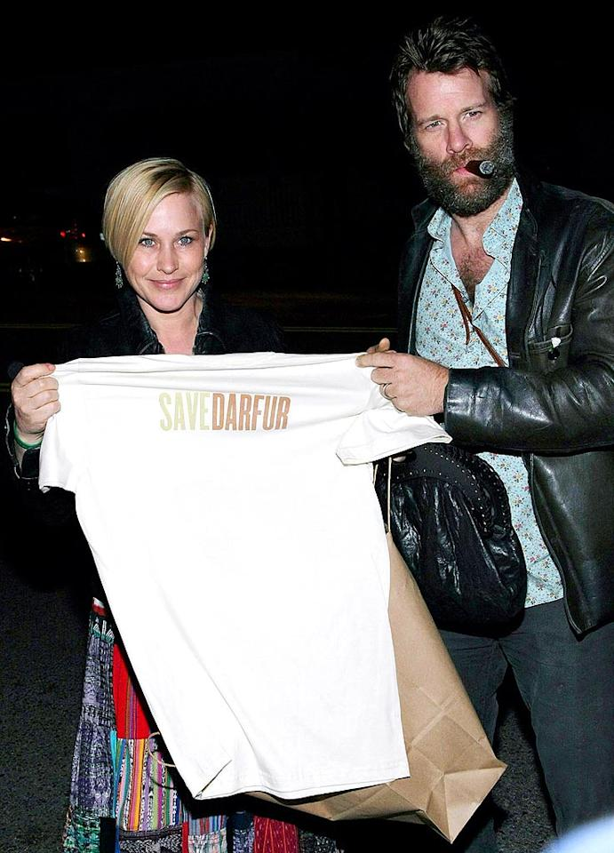 """Patricia Arquette and her husband, Thomas Jane, stocked up on Save Darfur T-shirts at the Propr store. The tops are available for purchase at Propr, or online at savedarfur.org. Noel Vasquez/<a href=""""http://www.gettyimages.com/"""" target=""""new"""">GettyImages.com</a> - December 17, 2009"""