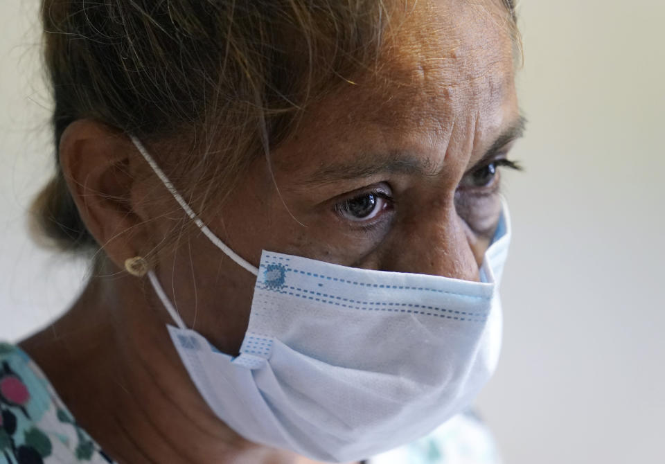 """Mileydis Tamayo, a nurse from Cuba who is living in Mexico while she seeks asylum in the U.S., works at a clinic set up for fellow asylum seekers also waiting, in Matamoros, Mexico. Led by U.S. military veterans, Global Response Management is staffed by volunteers primarily from the U.S. and paid asylum seekers who were medical professionals in their homelands. """"If this group wasn't here,"""" Tamayo said later. """"Many people would be in very bad shape."""" (AP Photo/Eric Gay)"""