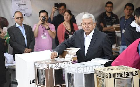 <span>Andres Manuel Lopez Obrador, casting his vote on Sunday morning</span> <span>Credit: AFP </span>