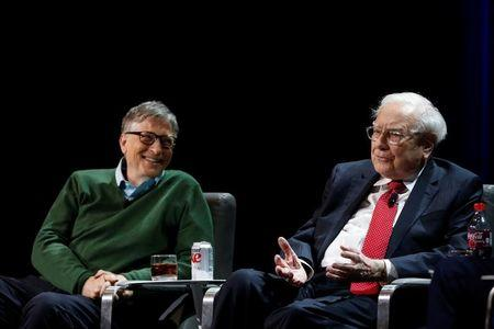 Warren Buffett, chairman and CEO of Berkshire Hathaway, speaks while Bill Gates looks on at Columbia University in New York, U.S., January 27, 2017. REUTERS/Shannon Stapleton